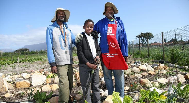 Orange Venge Songezo Magoqoza Full time Gardeners at Mokone Primary with Luxolo Ntsholo from the school gardening club