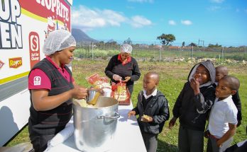 the shoprite team serving food to the learners
