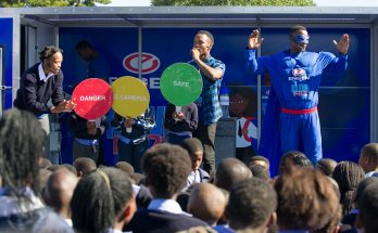 """Mr Wise"" and members of the Engen Kleva Kids team present a demonstration to the leaners of Nomlinganiselo Primary School in Nyanga, Cape Town, SOUTH AFRICA"