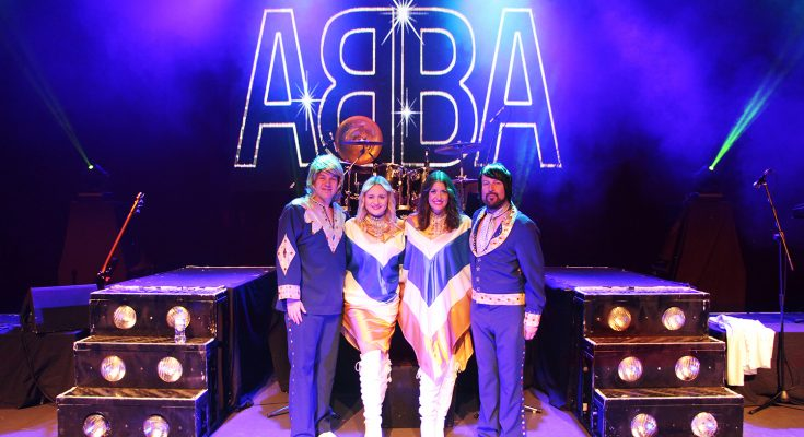 the main cast group photo of the abba show