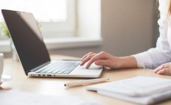 A women's hand on a laptop