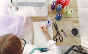 woman-in-white-long-sleeve-shirt-sketching-on-white-printer