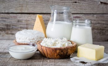 Selection of dairy products on rustic wood background, copy space